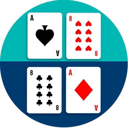 A table is divided in half, with an ace of spades beside an 8 of hearts on one side, and an 8 of clubs beside an Ace of diamonds on the other side.