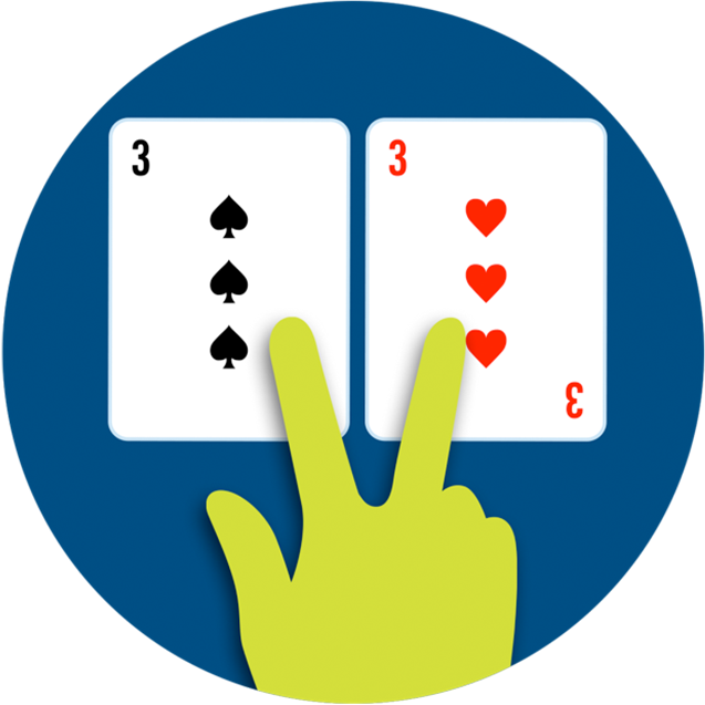 A hand splitting two cards with two fingers.
