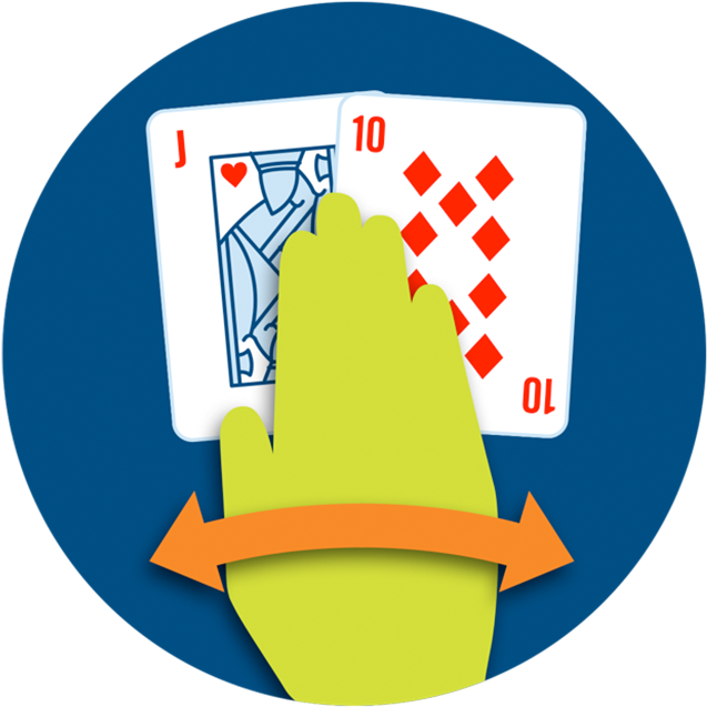 A hand waving over two cards.