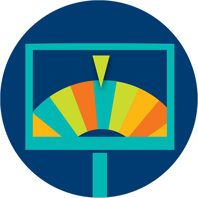 A monitor displays a multicoloured prize wheel with the pointer resting on a blue sliver.