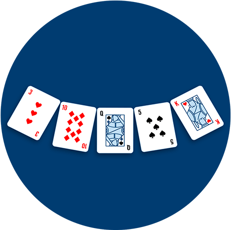 Five playing cards face down on the table in a semi-circle.