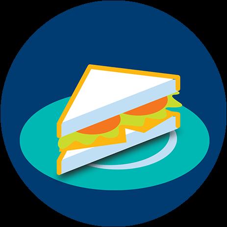 Dans une assiette, il y a la moitié d'un sandwich.