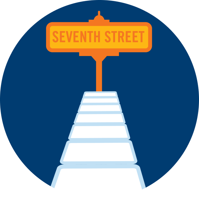 "A street sign that says ""Seventh Street"" is at the end of a row of cards."