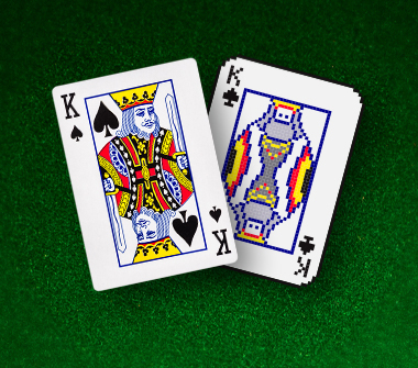 A physical card of the King of Spades is shown next to a digitized version of the King of Spades card.