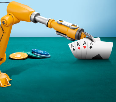 A robotic arm reveals four cards: an Ace of Clubs, an Ace of Diamonds, an Ace of Hearts and an Ace of Spades. Next to the cards is a small stack of casino chips.